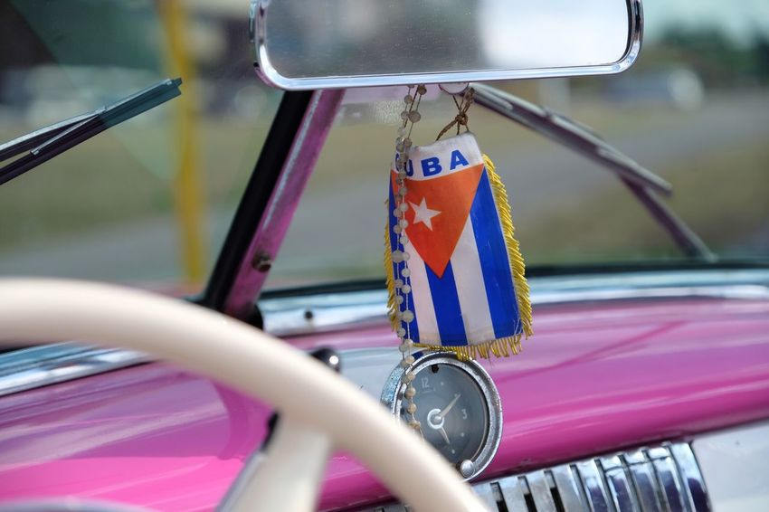 Cuban flag in a classic car Land Vehicle Flag Mode Of Transport Transportation Car Patriotism No People Day Outdoors Close-up