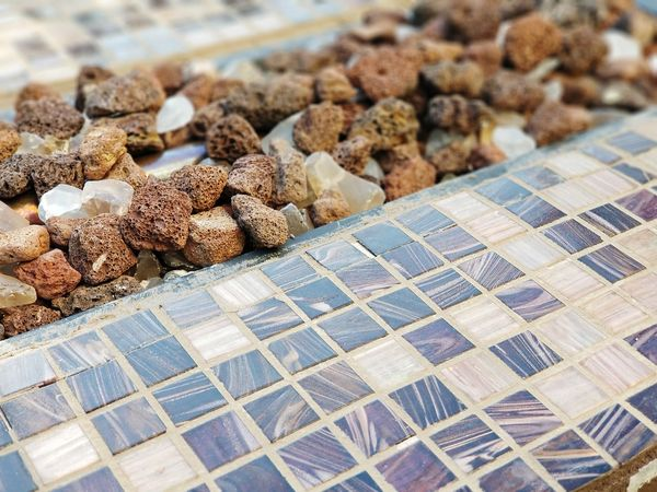 glass tiles and fireplace stones Bradleywarren Photography Bradley Olson Backgrounds Background Room For Text Copy Space Outdoor Rows Of Things Pattern Design The Way Forward Fire Pit Fireplace Tile Tiles Pattern Pieces Pattern Chicago Rock Stone Material Stones EyeEm Selects Solar Panel Solar Energy Close-up Alternative Energy Sustainable Resources Sustainable Lifestyle Fuel And Power Generation Power Supply