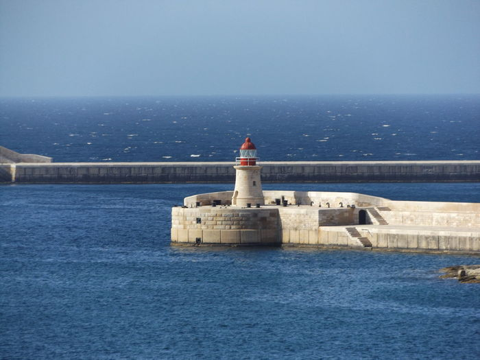 View on breakwaters of st. elmo and ricasoli, these are protecting the bay  nearby valletta, malta.