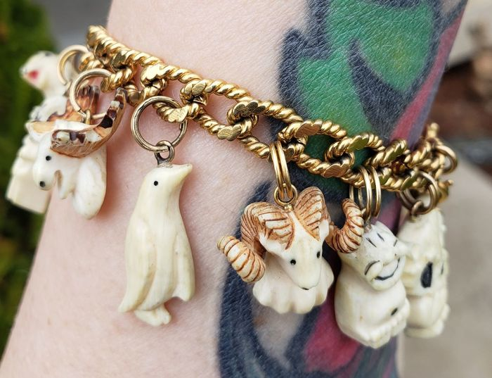 Gold Ivory Charm Charm Bracelet Monet Monet Jewelry Vintage Jewelry Macro Etsy Alaskan Art Eskimo Walrus Ivory EyeEm Selects Females Hanging Fashion Close-up Jewelry Gemstone  Semi-precious Gem Jeweller Bead Chain Locket Handmade Human Representation Jewelry Store