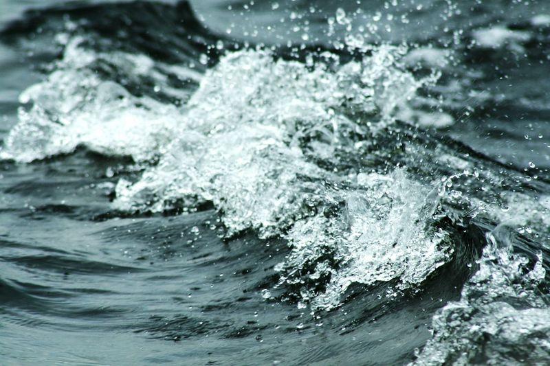 Close-up of sea wave rushing towards shore
