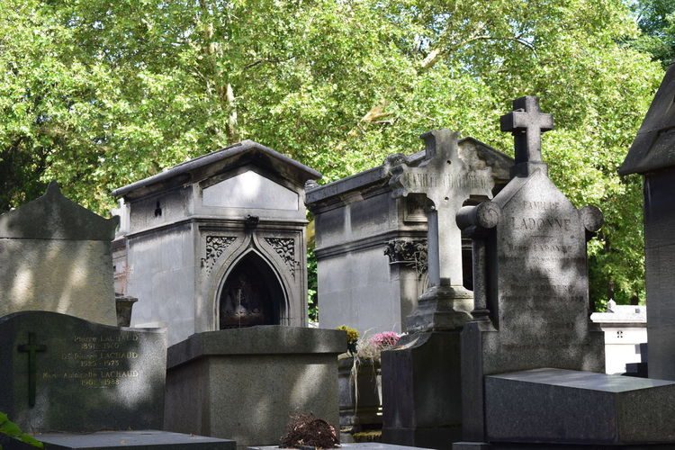 Père Lachaise Père Lachaise Architecture Art And Craft Belief Built Structure Cemetery Day Grave Human Representation Nature No People Outdoors Place Of Worship Plant Religion Sculpture Spirituality Statue Tombstone Tree