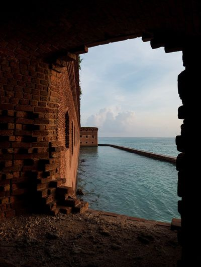 Fort Jefferson Brick Wall Frame Silhouette Sunset Florida Abandoned History Historical Building National Park Fort Jefferson Dry Tortugas Fujifilm Fort Water Sky Sea Built Structure Architecture Nature No People Tranquility Outdoors Building Cloud - Sky Beauty In Nature Tranquil Scene Sunlight Beach