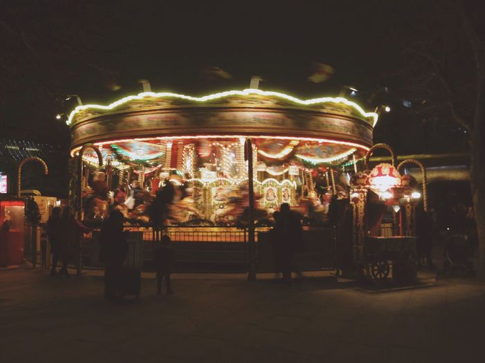 Illuminated Night Amusement Park Amusement Park Ride Blurred Motion Carousel Leisure Activity Large Group Of People Real People Outdoors