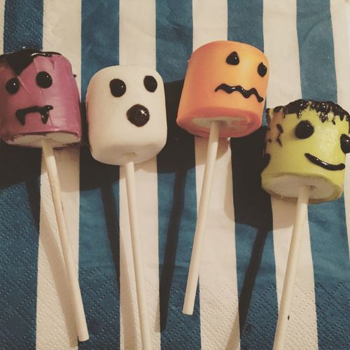 Close-up of faces made on marshmallows