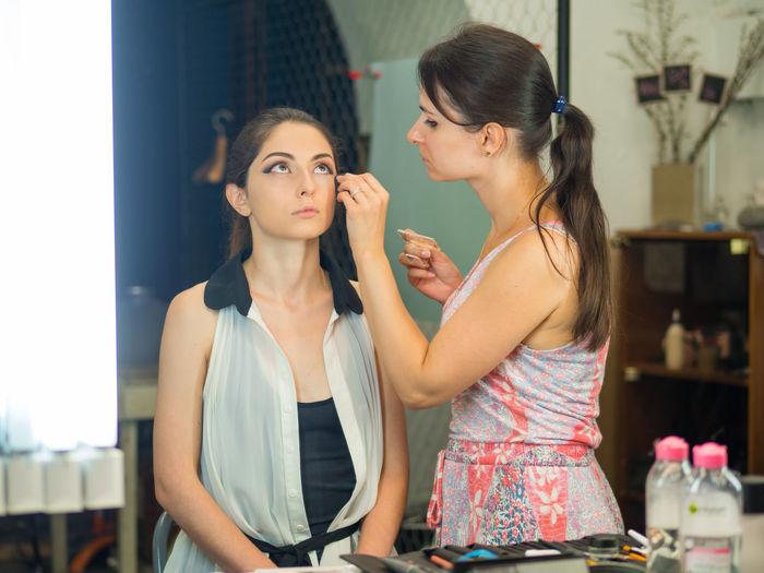 Beautician dressing customer at spa