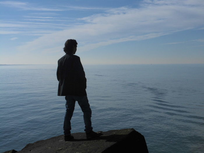 Sea Water Sky Standing One Person Horizon Beauty In Nature Scenics - Nature Rear View Full Length Horizon Over Water Real People Leisure Activity Nature Lifestyles Tranquility Non-urban Scene Cloud - Sky Looking At View