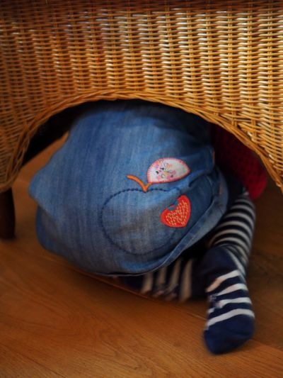 Home Interior Young Chair Rattan Stockings Behind Heart Apple Seeking Hide And Seek Hiding Jeans Creativity Directly Above Baby Furniture Textile Innocence Relaxation Cute Close-up Blue Casual Clothing Child Art And Craft High Angle View One Person Representation Childhood Indoors