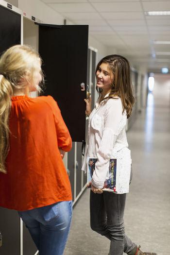 Smiling woman standing in corridor of building