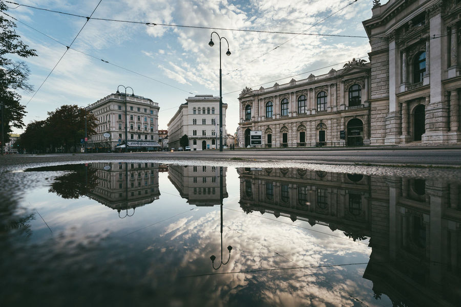 Morning perfection from cold and rainy Vienna Architecture Austria City Cityscape EyeEmNewHere Reflection Vienna Building Exterior Cloud - Sky No People Puddle Puddle Reflections Reflections In The Water Ringstrasse