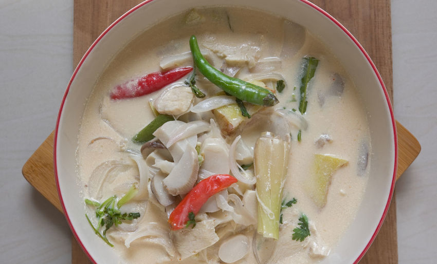 Tom Kha Gai (Thai Chicken Coconut Soup) : Thai Food Thaifood Spicy Food Soup Coconut Milk Chili Pepper Tom Kha Gai Soup Tom Kha Kai Food Food And Drink Healthy Eating Freshness Vegetable Wellbeing Ready-to-eat Indoors  Bowl Close-up Table No People Still Life Pepper High Angle View Serving Size Directly Above Red Chili Pepper