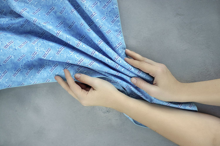 Woman hands with blue cleaner material