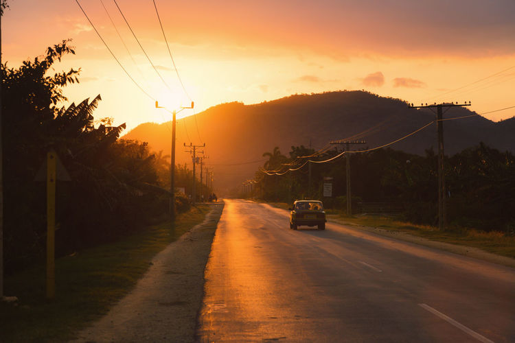 An Eye For Travel Beauty In Nature Electricity Pylon Eye4photography  Landscape Landscapes With WhiteWall Mountain Nature Orange Color Power Line  Road Road Sky Street Sunset Sunset_collection The Way Forward Transportation