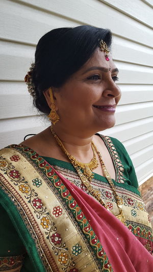Close-up of woman wearing sari and jewelry