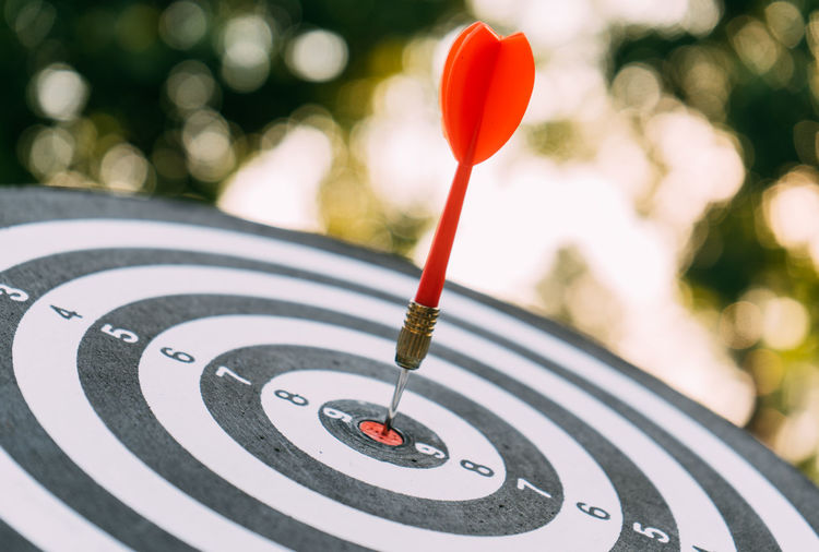 Target dart and arrow with abstract nature bokeh blur background