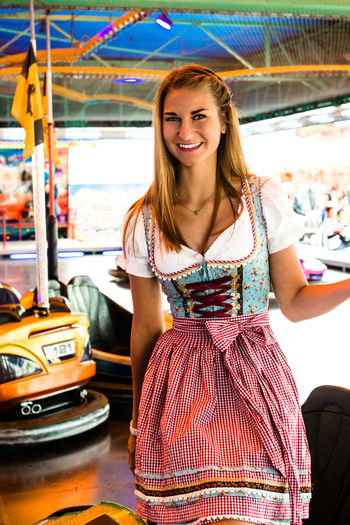 Portrait Of Happy Woman In Dirndl At Oktoberfest
