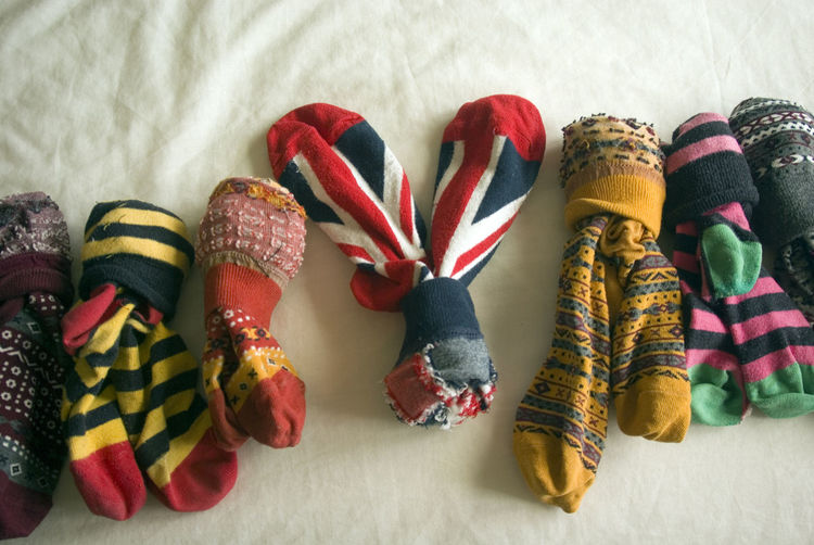 High angle view of various pair of socks at home