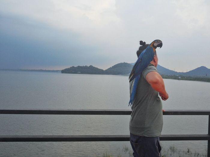 Macaw Dam Macaw Parrot Men EyeEm Selects Water Standing Mountain Lake Rural Scene Sky Mature Couple Mountain Range Rocky Mountains