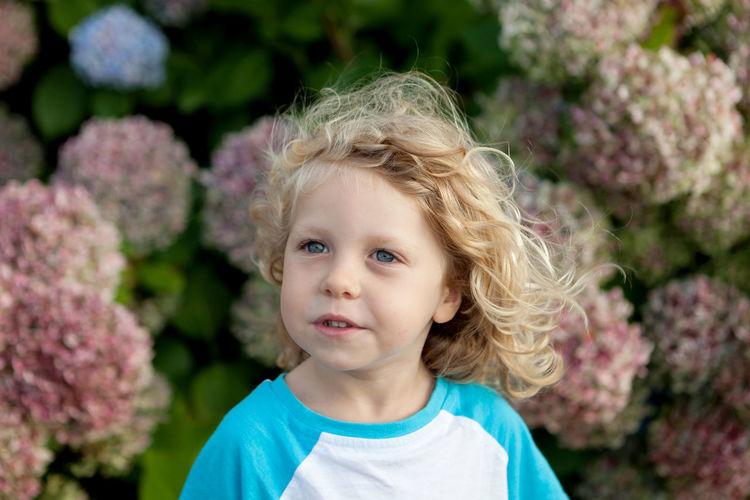 Cute girl against pink flowers