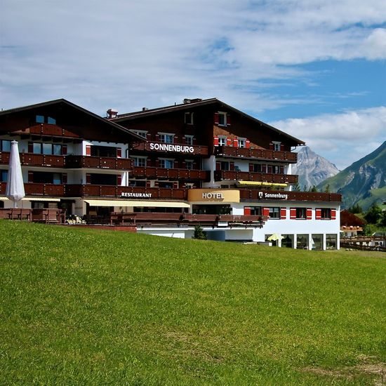 Alps Architecture Arlberg Austria Blue Building Exterior Clouds Getting Inspired Grass Green Green Color Hello World Hotel Lawn Lech Mountain Oberlech Sky Summer Taking Photos Traditional Vacations Walking Around Wooden Landscapes