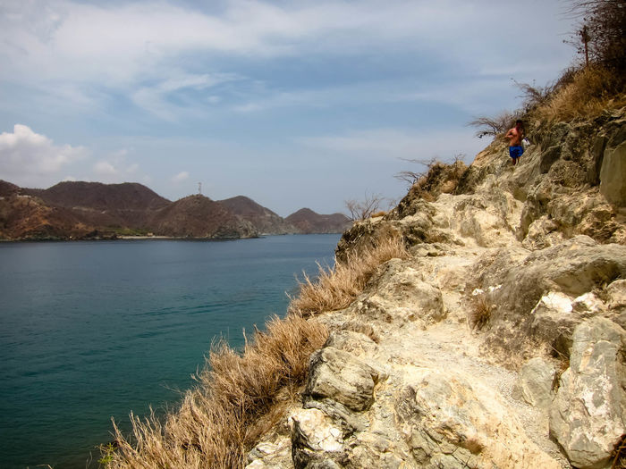 Taganga, Colombia Road Less Travelled Travel Walking Around Beach Beauty In Nature Cliff Day Mountain Nature Outdoors Scenics Sea Sea And Sky Sky Track Tranquil Scene Tree Walking Water