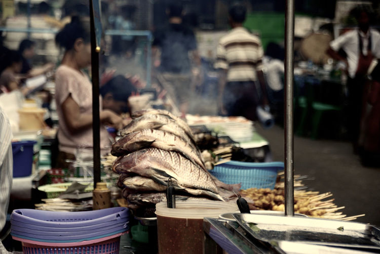Woman selling seafood at market
