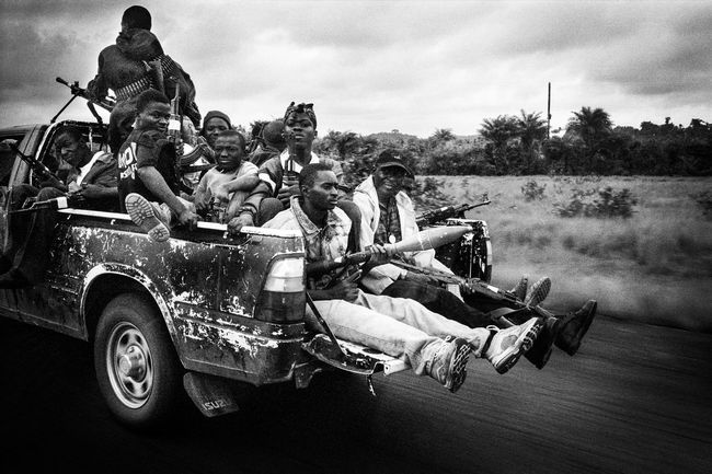 Lords of War Africa Analogue Photography Black And White Blackandwhite Child Soldier Civil War Crack Dangerous Drug Front Full Speed Guns Killer Liberia Men Monrovia Outdoors Pickup Rebels Tarmac Transportation War Memorial Weapon EyeEmNewHere