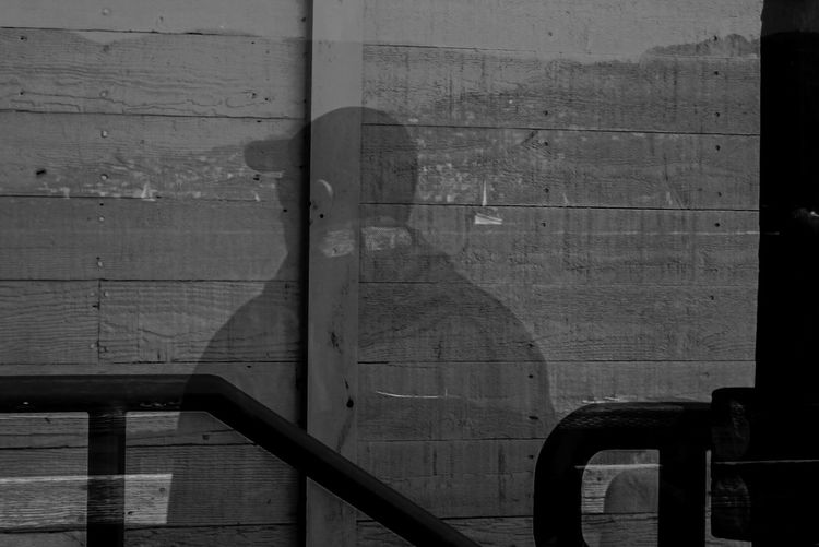 Weathered wood was the background to this window reflection of my partner when we visited pier 39 in San Francisco EyeEm Best Shots Pier 39 Reflection San Francisco Silhouette Sunlight Wall Wall - Building Feature Weathered Window Window Reflections The Innovator The Magic Mission