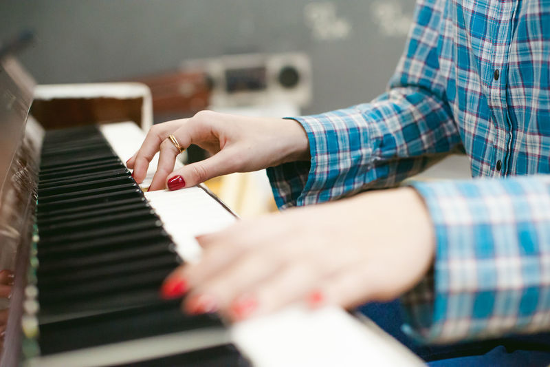 Close-up of woman playing piano