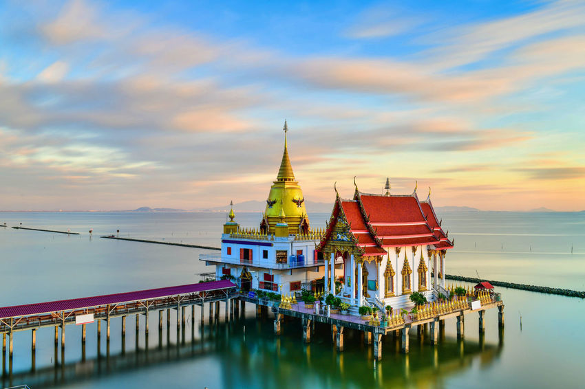 """""""Wat Hong thong"""" a temple built in the sea at sunset in chachengsao province Buddha Image Hong Thong Thailand Architecture Bangpakong Beauty In Nature Buddhism Building Exterior Built Structure Chachengsao Cloud - Sky Day Nature No People Outdoors Place Of Worship Religion Setset Sky Spirituality Sunset Temple Travel Destinations Water Waterfront"""