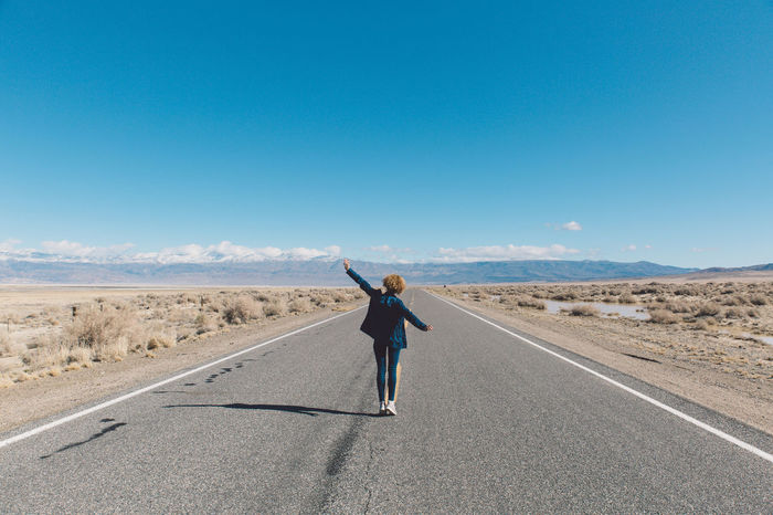 Arid Climate Arms Raised Blue Blue Sky CA-190 Coso Curly Hair Day Death Valley Desert Desert Full Length Girl Landscape Men Mountains Nature Olancha One Person Outdoors Real People Rear View Road Roadtrip Standing Breathing Space Breathing Space California Dreamin California Dreamin #FREIHEITBERLIN