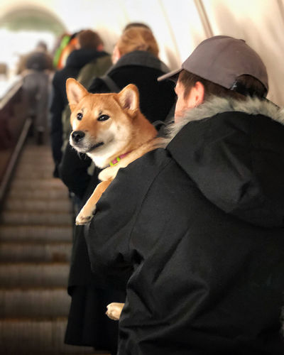 People with dog standing outdoors