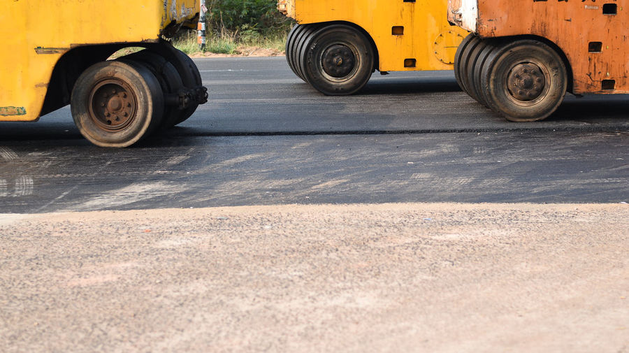 Asphalt Asphalt Asphalt Road Commercial Land Vehicle Construction Machinery Day Industry Land Vehicle No People Outdoors Road Details Road Machinery Road Marking Road Roller Steamroller Street Tire Tires Wheels Yellow Paint The Town Yellow