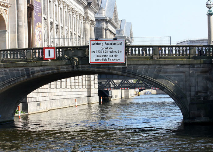 A Taste Of Berlin River Spree Berlin Arch Architecture Bridge Bridge - Man Made Structure Building Exterior Built Structure City Communication Connection Covered Bridge Day Footbridge Mode Of Transport No People Outdoors River Text Transportation Travel Destinations Water