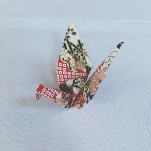 Directly above shot of origami paper crane on table