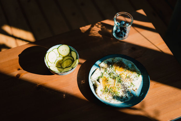 High angle view of breakfast served on wooden table