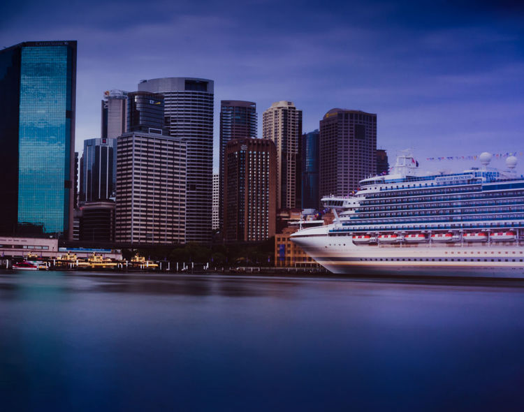 Cruise ship docked in Sydney Harbour City Skyscraper Urban Skyline Cityscape Reflection Travel Destinations Travel Modern Architecture Sky No People Sea Nautical Vessel Cruiseship Sydney Futuristic Sydneyharbour Travelphotography Travel Travelaustralia Cruise Cruise Liner Blue Urban Buildings EyeEmNewHere The Architect - 2017 EyeEm Awards
