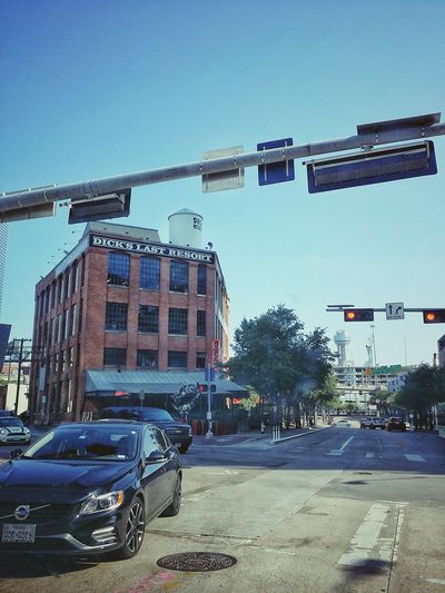 downtown street Brick Pavement Road Streetphotography Downtown City Clear Sky Land Vehicle Car Sky Architecture Building Exterior Built Structure Road Signal Traffic Signal Crossroad Road Intersection Street Scene Traffic Light  Signal