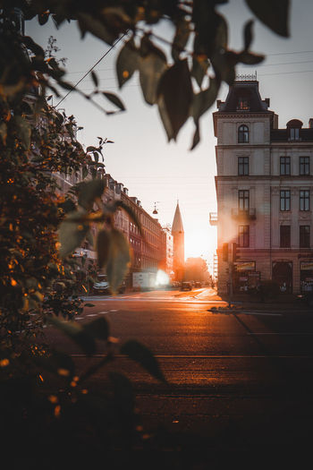 Sunset in Copenhagen. Summer time in the city. Architecture Building Outdoors Sunset City Sun Sun Beams Orange Color Old Buildings Moody Evening Morning City Cityscape Downtown Beautiful Copenhagen Denmark Amazing