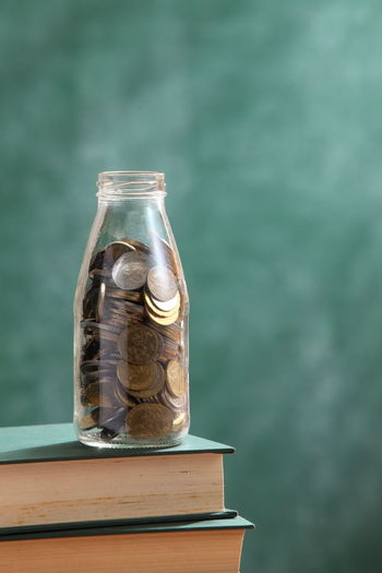 saving for education Currency Schlorship Blackboard  Book Cash Chalkboard Close-up Coins Donation Education Finance Fund Future Jar Money No People Save Saving Jar Savings Still Life