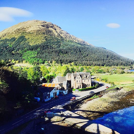 Stunning scenery as viewed from a bridge EyeEmNewHere Loch Linnhe Lochaber Loch  Scotland Scottish Highlands Glencoe Ballachulish Hotel Architecture Mountain Day Built Structure History Tree Outdoors No People Sunlight Sky Nature Scenics Travel Destinations Clear Sky EyeEmNewHere An Eye For Travel
