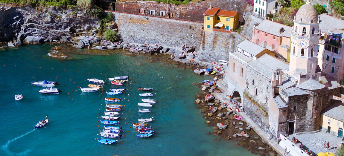 Aerial view of residential buildings by sea at cinque terre
