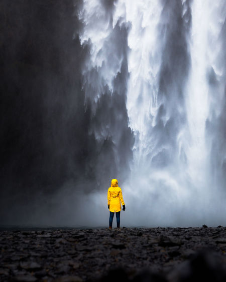 The powerful Skogafoss. This Beast is 60 meters high. Standing next to it felt unreal. Iceland Beauty In Nature Cloud - Sky Full Length Human Arm Iceland_collection Land Leisure Activity Lifestyles Men Model Nature One Person Outdoors Pollution Power In Nature Real People Rear View Skogafoss Sky Smoke - Physical Structure Standing Women Yellow Young Adult The Traveler - 2018 EyeEm Awards