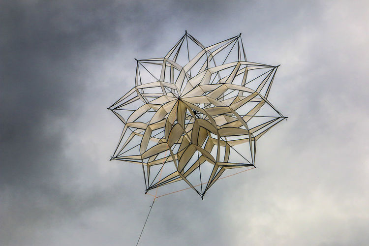 Low angle view of decoration against cloudy sky