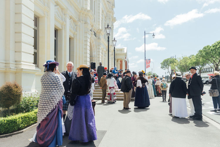 Panoramic view of people in town square