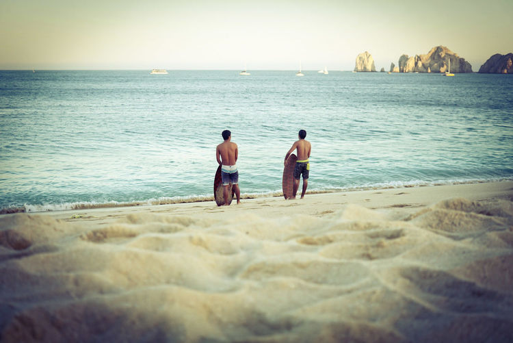 Two people relaxing on beach