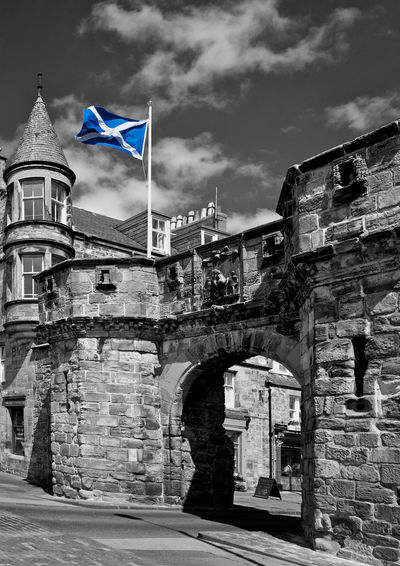 Architecture Built Structure Building Exterior Flag Sky Building History Arch The Past Cloud - Sky Patriotism No People Old Travel Destinations Nature Day Wall City Low Angle View Stone Wall Brick St Andrews Cross St Andrews Scotland St Andrews Nationalism