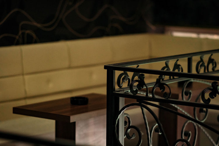 Close-up of railing against table at home