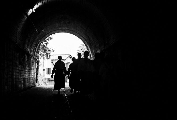 Samurai walking in tunnel
