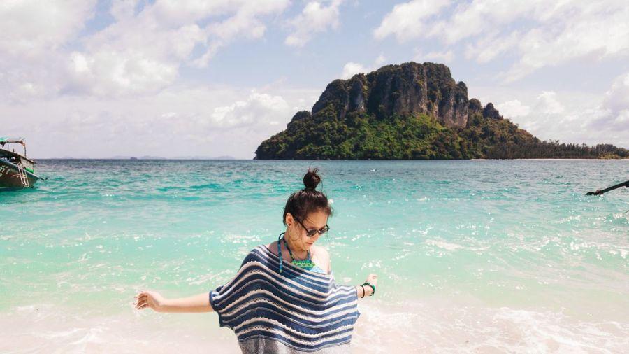 Teenage Girl Standing Against Sea At Beach